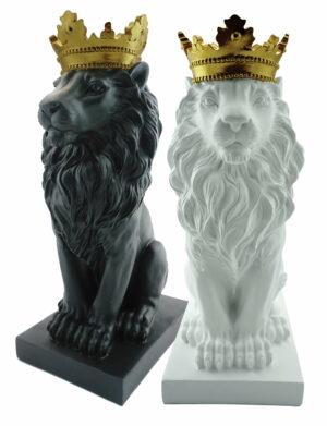 Dwie figurki ozdobne czarna i biała przedstawiające siedzącego lwa w złotej koronie