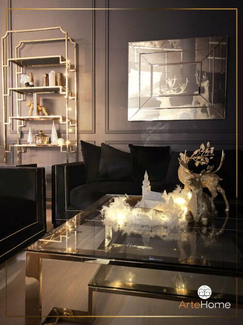 Ekskluzywne wyposażenie wnętrz - stolik kawowy złoty oraz welurowa czarna sofa - ArteHome