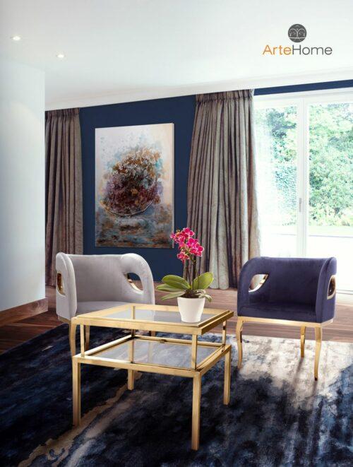 Stolik kawowy janssen złoty fotele Morello szary i niebieski obraz Accarti aranżacja salonu