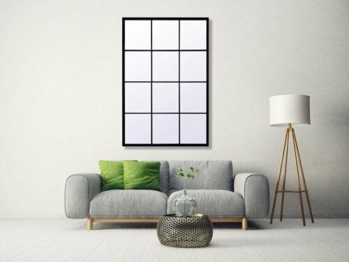 Lustro okienne prostokątne w metalowej rami wiszące na ścianie nad szarą sofąe